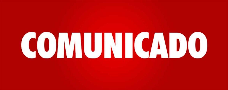 Letrero rojo con la palabra comunicado en blanco