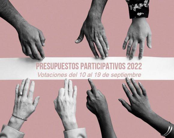 Unas manos sostienen una tira en la que está escrito Presupuestos Participativos